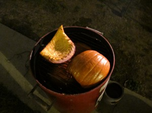 If you don't want to go the extreme route, you can always be, well, sensible. I gutted and quartered a medium pumpkin, then smoked the shards skin-side up over charcoal for 90 minutes, too. It doesn't yield the 5 or more quarts of smoked pumpkin flesh you get from the big brother, but you'll still have plenty of the stuff for a good smoked pumpkin soup or smoked pumpkin pie. You also get more seeds and if you have a pie tin with some holes in it, you can dry them and smoke them for a snack as well.