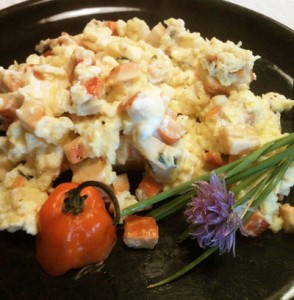 Scrambled eggs with chevre, chives, habanero, and mushrooms.