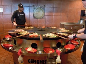 """Griddle-cooking """"Mongolian barbecue stir-fry"""" at a Genghis Grill restaurant in the U.S."""