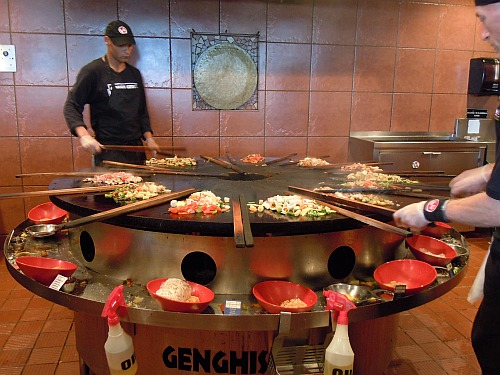 "Griddle-cooking ""Mongolian barbecue stir-fry"" at a Genghis Grill restaurant in the U.S."