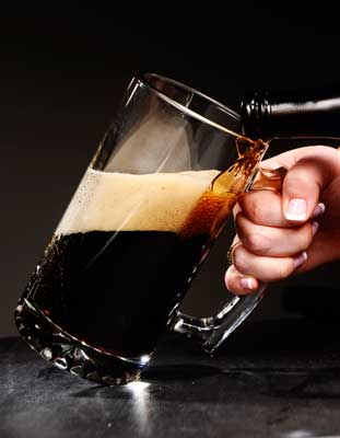 Dark Beer Poured Into Mug