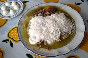Green enchiladas with refried beans