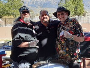 Fiber Joe, Nevin Montano, and CaJohn getting ready to treat the crowd to shrimp and veggies done up with CaJohn's Black Garlic Hot Sauce.